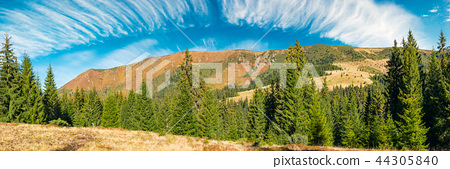 mountain ridge under the gorgeous sky with clouds 44305840