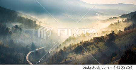 panorama of countryside in glowing fog 44305854
