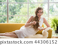 Young woman holding a bowl of yogurt 44306152