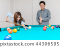 Happy couples are playing billiards in home, 44306595