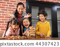 Asian Kids are playing wooden blocks stack game 44307423