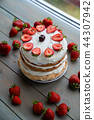 Strawberry cake on wooden table 44307942