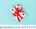 Gift box red stars blue background Voucher card  44311215