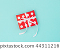 Gift box red white blue background Festive deco 44311216