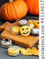 Halloween scary cookies with pumpkin on wooden cut board. pattern Bat , patina, ghosts and spiders 44314617
