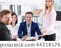 Group of people sit in office deliberate 44318176