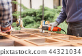 Carpenter at work with angular Sander. 44321034
