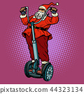Santa Claus biker with Christmas gifts rides an electric scooter 44323134