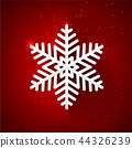 Snow flake with glittering over dark red 44326239