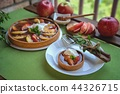 Apple tart with caramel on white plate 44326715