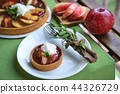 Apple tart with caramel on white plate 44326729