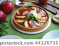 Apple tart with caramel on white plate 44326735