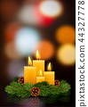 Christmas burning candles 44327778