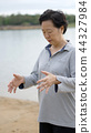 Asian Senior Elderly Qi Gong exercise outdoor 44327984