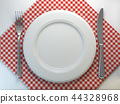 Top view of clean white plate on a tablecloth 44328968