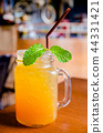 iced tea in glass bottle with mint leaves 44331421