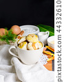 Close up cookies with cashew nut in a white cup. 44332610