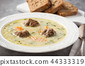 Creamy vegetable soup with beef meatballs. 44333319