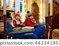 Kids at Christmas fair. Child at Xmas market. 44334195