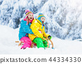 Kids play in snow. Winter sled ride for children 44334330