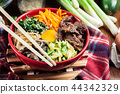 Bibimbap - rice with beef and vegetables 44342329