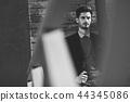 Attractive man wearing british elegant suit in the street. Moder 44345086