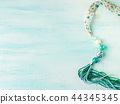 Girl's necklace on turquoise 44345345