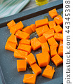 Chopped pumpkin drizzled with oil for baking 44345398