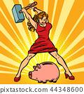 woman breaks piggy Bank. Finance, Economics and consumption 44348600