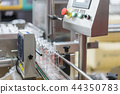 Clear water Bottles transfer on Conveyor Belt  44350783