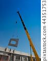 Construction crane lifting  precast concrete wall 44351753