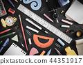 school supplies on black wood 44351917