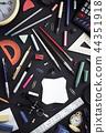 school supplies on black wood 44351918