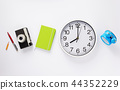 wall clock and notebook with camera 44352229