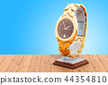 Golden wrist watch on the stand holder 44354810