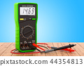 Digital multimeter on the wooden table 44354813