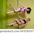 Two women in the pole dance studio 44358347