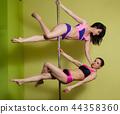 Two women in the pole dance studio 44358360