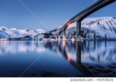 Bridge with illumination and mountains at night 44359828