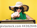 Young woman with a suitcase travel theme 44362646