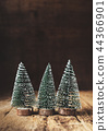 Three mini christmas tree wood on rustic wooden 44366901