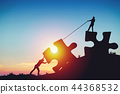 People silhouettes putting puzzle pieces together on sunlight background 44368532