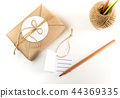 Gift box wrapped in kraft paper and rustic hemp 44369335