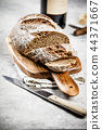 Freshly baked traditional bread and wine  44371667