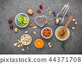 Ingredients for a healthy foods background. 44371708