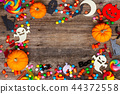 Colorful halloween candies on wood 44372558