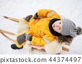Little boy enjoying a sleigh ride 44374497