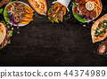 Top down view on traditional turkish meals on black stone table. 44374989
