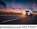 Truck with container on road, cargo transportation concept. 44374997