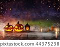 Halloween pumpkins on old wooden planks. 44375238